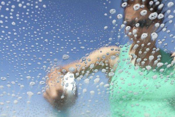 car cleaning hack spraying a car window